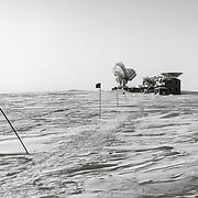 The Dark Sector Lab a half kilometer walk from the Amundsen-Scott South Pole Station. The Dark Sector Lab  houses the South Pole Telescope (left) and the BICEP3 Telescope.