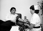 With a possible shortage of blood looming over the St Patrick's weekend, Irish rugby international Tony Ward leads an awareness campaign by donating blood at Pelican House, Mespil Road, Dublin. It clearly doesn't hurt a bit, as Tony chats with Nurse Barbara Maguire during the donation.<br />