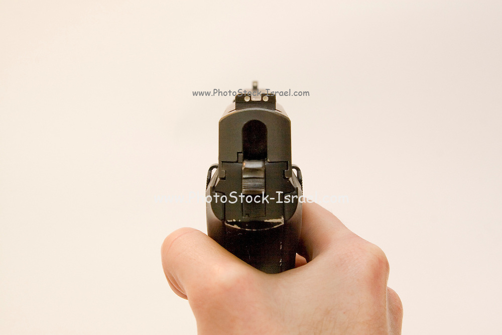 back view of a male hand holding a Czech CZ-99 9mm parabelum semi-automatic hand gun Cut out on white background