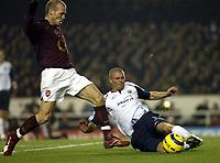 Photo: Chris Ratcliffe.<br />Arsenal v West Ham. Barclays Premiership. 01/02/2006.<br />Arsenal's Freddie Ljungberg (L) is tackled by Paul Konchesky.