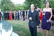 ALAIN DE BOTTON; CHARLOTTE DE BOTTON, 2009 Serpentine Gallery Summer party. Sponsored by Canvas TV. Serpentine Gallery Pavilion designed by Kazuyo Sejima and Ryue Nishizawa of SANAA. Kensington Gdns. London. 9 July 2009.