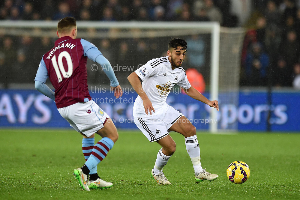 Neil Taylor of Swansea city in action (r) .Barclays Premier league match, Swansea city v Aston Villa at the Liberty stadium in Swansea, South Wales on Boxing Day, Friday 26th December 2014<br /> pic by Andrew Orchard, Andrew Orchard sports photography.