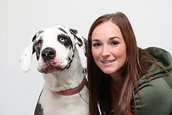 """EXCLUSIVE: A Great Dane who didn't like cats has stopped a kitten going blind by donating blood used in sight-saving eye drops. Huge dog Harlie, who weighs around nine stone, put her best paw forward to give blood used to treat Zephyr the rescued kitten. Vets treated eight-week-old Zephyr with serum drops which used elements of Harlie's blood after it has been separated using a centrifuge. The liquid part of the blood is made into drops which help the surface of the eye to heal and stop the tissue breaking down. Rescuers feared the worst for Zephyr but her sight has now been saved thanks to her huge donor friend Harlie. Steph Taylor, from charity Rescue Me Animal Sanctuary, said Zephyr was found with three siblings under a shed in Liverpool, England. She said: """"They were all full of flu which had led to secondary pneumonia, horrific conjunctivitis with ulcerated eyes, ticks, severe flea infestation leading to anaemia and dehydration. """"The serum from Harlie was fairly unusual for us to use and we have never done it before, there are several types of conventional medicated drops and we used these first but as Zephyr was not responding to these, our vet suggested it. """"We had heard of it once before when another rescue spoke about it and they had amazing results. """"We have four dogs at our HQ but sadly none were suitable blood donors due to their size, age or health problems so we had to turn to the public for help… and along came Harlie."""" Harlie's owner Jess said she wanted to help but at first she feared Harlie wasn't used to cats and it might not be a good idea for her to meet Zephyr in person. Jess, 30, a foster carer from Liverpool, England, said meeting Zephyr was the first time her huge hound had met a feline in person. Jess, who has three other dogs, a Staffordshire bull terrier, and two shih tzu Yorkshire terriers, said she wanted to help after seeing an appeal for blood donors to produce the serum used for the eye drops. She said: """"We were"""
