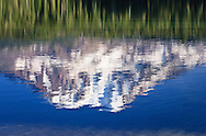 Mt Adams rippled reflection in Takhlakh Lake in the Gifford Pinchot National Forest, Cascade Mountain Range, WA