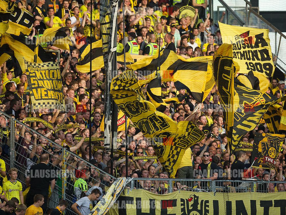 FOOTBALL: Dortmund fans celebrating before the Bundesliga match between 1. FSV Mainz 05 and Borussia Dortmund at Coface Arena on September 20, 2014 in Mainz, Germany. Photo: Claus Birch.