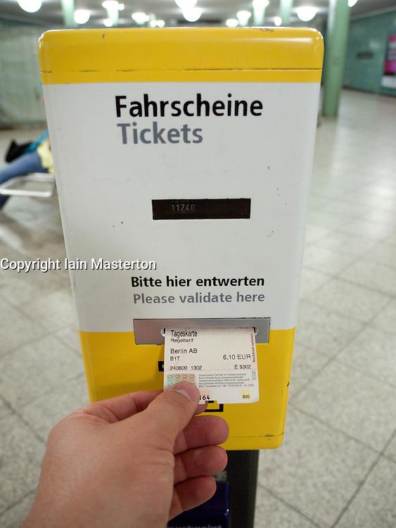 Detail of subway ticket validation machine on platform of underground railway station in Berlin Germany