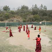 Young monks playing football at the Punakha monastery.