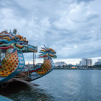 Tourist boats on the Perfume River in Hue, Vietnam.