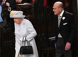 Queen Elizabeth II and the Duke of Edinburgh arrive ahead of the wedding of Princess Eugenie to Jack Brooksbank at St George's Chapel in Windsor Castle.