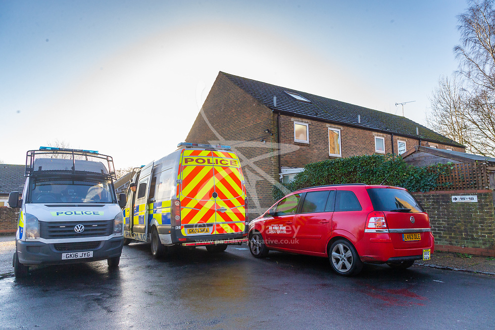 A red private hire minicab allegedly driven by the man arrested is parked behind police vans outside the house Police are searching in New Ash Green, Kent, home of the former partner of a mother who went missing over two months ago, after his re-arrest on suspicion of murder. New Ash Green, Kent, December 20 2018.
