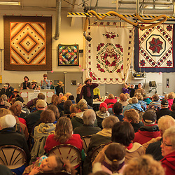 Amish auction quilts to raise funds for the Bart Volunteer Fire Company at the annual mud sale in Lancaster County, Pennsylvania.