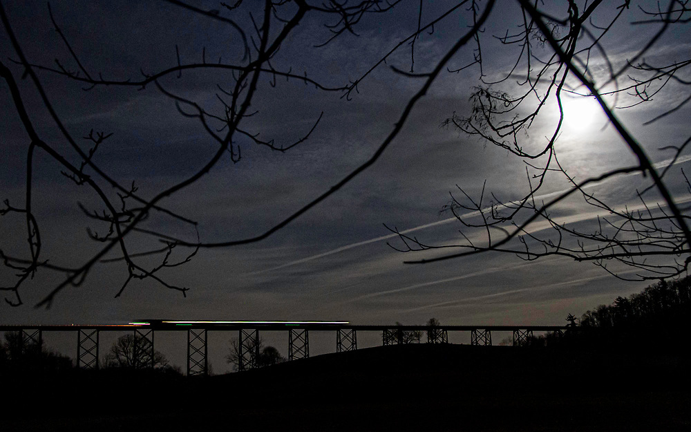 Crossing the massive Moodna Viaduct under a full moon, this MetroNorth commuter train continues its westward trek towards the end of the line at Port Jervis