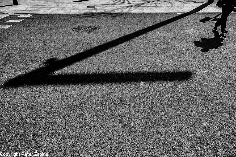 A pedestrian is crossing a street in Barcelona, Spain.