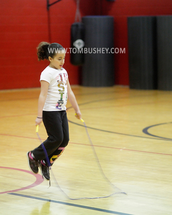 Middletown, New York - A girl jumps rope at Family Night at the Middletown YMCA on April 2, 2011.