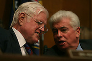 Senator Ted Kennedy and Senator Christopher Dodd talk  at the confirmation hearing of Tom Daschle to be the Secretary of the Departmemnt of Health and Human Services on January 8, 2009.  Photograph by Dennis Brack
