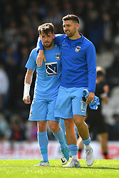 Coventry City's Marc McNulty (left) and James Pearson celebrate at the final whistle
