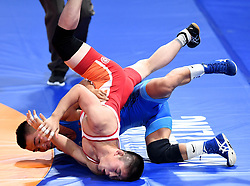 JAKARTA, Aug. 19, 2018  Bekhbayar Erdenebat (Rear) of Mongolia vies with Kang Kum Song of the Democratic People's Republic of Korea during Men's Wrestling Freestyle 57 kg Final of the 18th Asian Games in Jakarta, Indonesia, Aug. 19, 2018. Erdenebat won 8-2. (Credit Image: © Yue Yuewei/Xinhua via ZUMA Wire)