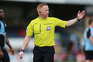 Referee assistant Alan Young who replaced main Referee Brendan Malone during the 1st half as Referee Brendan Malone was taken off for a calf injury. Skybet football league two match, Wycombe Wanderers  v AFC Wimbledon at Adams Park  in High Wycombe, Buckinghamshire on Saturday 2nd April 2016.<br /> pic by John Patrick Fletcher, Andrew Orchard sports photography.