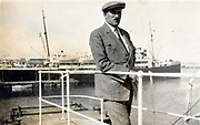 person standing on the captains lookout bridge of a large passenger ship
