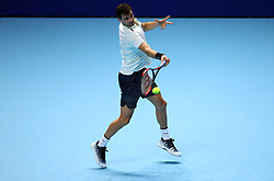 Grigor Dimitrov in action during his singles match against Dominic Thiem during day two of the NITTO ATP World Tour Finals at the O2 Arena, London. PRESS ASSOCIATION Photo. Picture date: Monday November 13, 2017. Photo credit should read: John Walton/PA Wire. RESTRICTIONS: Editorial use only, No commercial use without prior permission