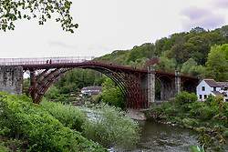 April 27, 2019 - The Iron bridge, which crosses the River Severn in Shropshire, is the first iron bridge ever cast and constructed in the world. It was erected in 1779 and was greatly celebrated after its construction due to the use of the new material. In 1986, the bridge together with the adjacent settlement of Ironbridge and the Ironbridge Gorge became part of the UNESCO World Heritage Site of the Ironbridge Gorge, and the site has become a major tourist attraction within Shropshire. A recent restoration project in 2018 has replaced its grey-blue colour with the bridge's original red-brown colour (Credit Image: © Mat Duckett/IMAGESLIVE via ZUMA Wire)