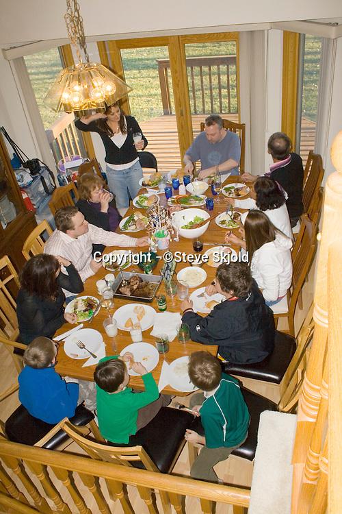 Family eating Easter dinner.  Mahtomedi Minnesota USA