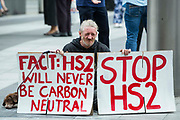 """Stop HS2 campaigner Scott Breen takes part in outreach activities in front of a HS2 Routewide Roadshow at Kings Cross Square on 5th August 2021 in London, United Kingdom. There have been increasing doubts regarding the viability of the northern section of the HS2 high-speed rail link since a recent report published by the Infrastructure and Projects Authority gave Phase 2b the lowest red rating, indicating that successful delivery of the scheme """"appears to be unachievable""""."""