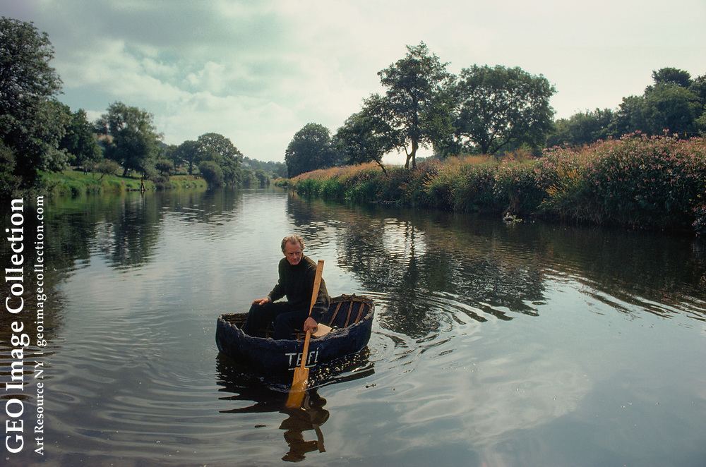 A Welshman navigates the river in his tub-shaped coracle.