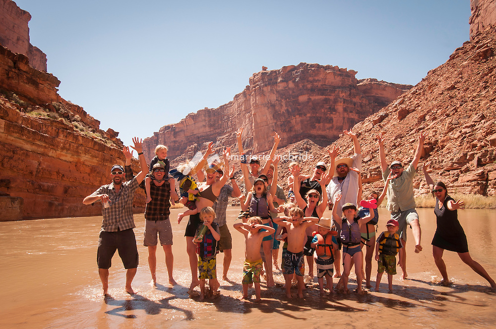 Enjoying sand flats in the river, San Juan River canyon family desert rafting trip, souther Utah.