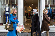 Smartly dressed women walking past one of the many designer shops on the King's Road, Chelsea, London, United Kingdom.  This district of London is very affluent and is famous for its international retailers, leading restaurants and cafes and luxury offices.