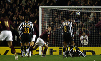 Photo: Chris Ratcliffe.<br /> Arsenal v Juventus. UEFA Champions League. Quarter-Finals. 28/03/2006.<br /> Cesc Fabregas celebrates scoring the opening goal for Arsenal by pointing at Thierry Henry