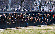 Environmental activists zip-tie themselves to the fence as they wait to be arrested during a rally in opposition to the Keystone XL Pipeline on the sidewalk in front of the White House at the White House in Washington.