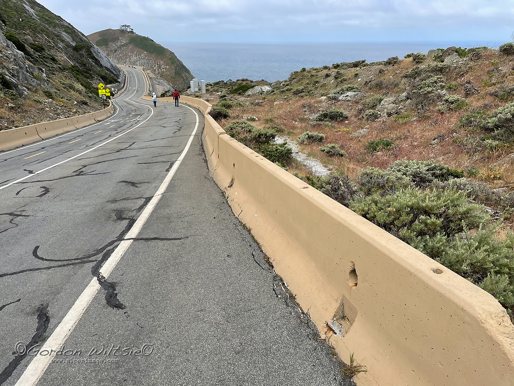 Hikers walk along an abandoned section ofCalifornia Highway 1 winds through The Devils Slide south of San Francisco.