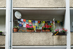 Decorated balcony  of social housing apartment building in Neukolln Berlin Germany