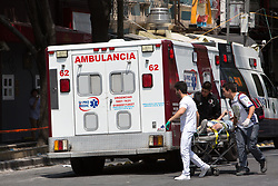 A survivor is transported to an ambulance at the site of acollapsed building in the neighborhood of Condesa, after a quake rattled Mexico City, Mexico on September 19, 2017. The 7.1 magnitude earthquake rocked Central Mexico, killing dozens people and causing serious damage to buildings in the capital. The worst earthquake in the history of Mexico occurred on September 19, 1985, killing nearly 10,000 people. (Photo by Bénédicte Desrus/Sipa USA)