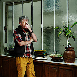 PARIS, FRANCE. NOVEMBER 23, 2012. Belgian photographer Harry Gruyaert from Magnum Photo in his home. Photo: Antoine Doyen