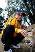 Child (10 years old) feeding a Wallaby. Sydney, Australia