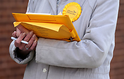 A Liberal Democrat party Teller outside Trumpington village hall in Cambridgeshire, as voters cast their ballots in local council elections.