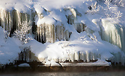 Icicles hang from the banks of a lake in Jarfjord near Kirkeness, Finnmark region, northern Norway