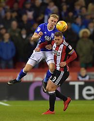 Birmingham City's Marc Roberts battles with Sheffield Unuted's Billy Sharp