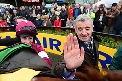 Road To Respect winning jockey Bryan Cooper is joined by owner Michael O'Leary after the Ryanair Gold Cup Novice Chase during the Easter Festival at Fairyhouse Racecourse, Co. Meath, Ireland.