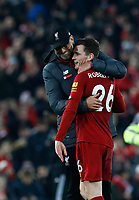 Football - 2019 / 2020 Premier League - Liverpool vs. Wolverhampton Wanderers<br /> <br /> Liverpool manager Jurgen Klopp celebrates with Andy Robertson in front of the Kop after his side gains a 1-0 win, at Anfield.<br /> <br /> COLORSPORT/ALAN MARTIN