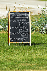 24 July 2018:   Chalk board menu sign advertising Taco Tuesday mexican style cuisine