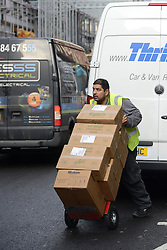 © Licensed to London News Pictures.17/01/2014. London, UK A driver delivers boxes on Wardour Street in Soho, London. Wardour Street in Soho is the most ticketed road in the country, according to figures obtained under the Freedom of Information Act. Between January and October last year 5,143 tickets were issued, raising up to £410,000.Photo credit : Peter Kollanyi/LNP