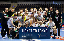 Team Germany celebrates with a big Ticket to Tokyo after wiinning during handball match between National Teams of Algeria and Germany at Day 3 of IHF Men's Tokyo Olympic  Qualification tournament, on March 14, 2021 in Max-Schmeling-Halle, Berlin, Germany. Photo by Vid Ponikvar / Sportida