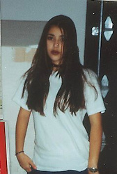 """Kim Kardashian releases a photo on Twitter with the following caption: """"""""1992"""""""". Photo Credit: Twitter *** No USA Distribution *** For Editorial Use Only *** Not to be Published in Books or Photo Books ***  Please note: Fees charged by the agency are for the agency's services only, and do not, nor are they intended to, convey to the user any ownership of Copyright or License in the material. The agency does not claim any ownership including but not limited to Copyright or License in the attached material. By publishing this material you expressly agree to indemnify and to hold the agency and its directors, shareholders and employees harmless from any loss, claims, damages, demands, expenses (including legal fees), or any causes of action or allegation against the agency arising out of or connected in any way with publication of the material."""