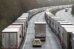 © Licensed to London News Pictures 22/12/2020.        Ashford, UK. F*CK 2020 written on the back of a lorry being escorted out of the queue by police. Hundreds of freight lorries remain stranded on the M20 in Kent today as France keep their borders closed due to fears over the new Cornavirus strain. Photo credit:Grant Falvey/LNP