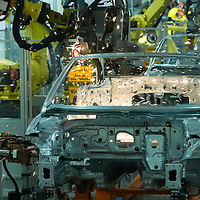 Automatised system works on assembling a car belonging to the Audi TT family in the Audi factory in Gyor (about 120 km West of Budapest), Hungary on November 05, 2014. ATTILA VOLGYI
