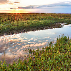 Sunset over the tidal marsh at the Massachusetts Audubon Wellfleet Bay Wildlife Sanctuary in Wellfleet, Massachusetts. Cape Cod. HDR.