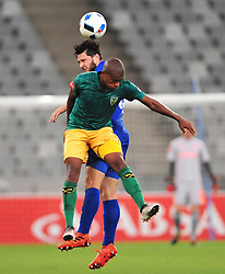 Cape Town--180401  Golden Arrows midfielder Danny Vener  challenged by Roland Putshe of Cape Town City  in a PSL game at the Cape Town Stadium. .Photographer;Phando Jikelo/African News Agency/ANA